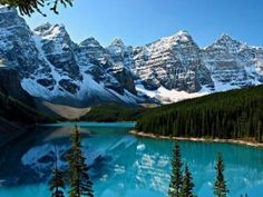 Moraine Lake, Banff National Park. Bright water, green pines, and snow topped mountains. | 100 most beautiful places in the world