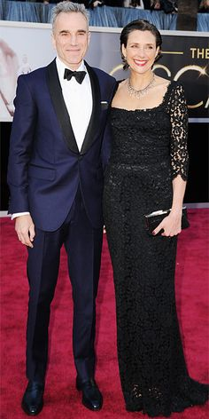 Daniel Day-Lewis in a tuxedo and Rebecca Miller in a black column at the Oscars, 2013