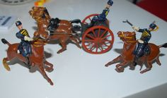 EARLY BRITAINS UNREPAINTED LEAD CARRIAGE WITH DRIVER & 2 MOUNTED CAVALARY MEN