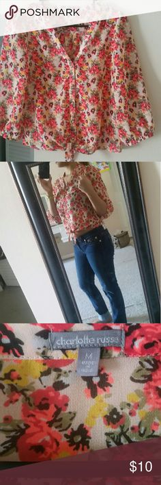 Floral button up shirt Adorable, loose, floral, button up, mesh blouse. The length of the sleeves are about 3/4. Worn a couple of times and in perfect condition. Charlotte Russe Tops Blouses