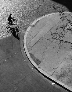André Kertész - Paris (man on bicycle), 1948