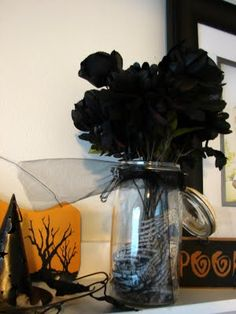 """Halloween Decor: I like the idea of painting cheap silk flowers and also using chalk markers to """"alter"""" family photos with eye patches, mustaches, etc :)"""