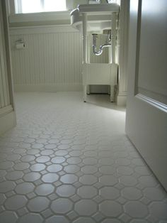 White porcelian, hexagon floor tile shown installed. The type of floor we have installed in kids bathroom. Very cheap tile but wow makes a great look. Easy to install as it is mounted on mesh.