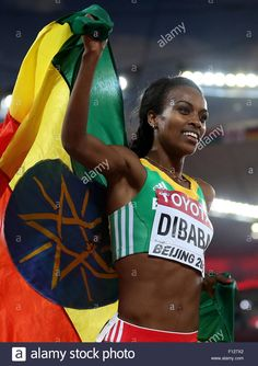 AUGUST Ethiopia's Genzebe Dibaba poses with her national flag as she wins the women's final on Day 4 of the IAAF World Championships in Trendy Womens Shoes, Womens Fashion For Work, Suits For Women, Fit Women, Black Women, National Stadium, National Flag, Female Athletes, Women Athletes