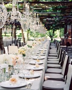 Chandeliers sparkled overhead these tables, which were set with pastel blooms, including cream-colored peonies and peach garden roses.