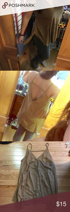 Suede low back tank Never wore it (except in picture:)) cute tank looked good with jeans or black pants, doesn't have a size rage but could fit any size , drapes nicely Rue 21 Tops Tank Tops