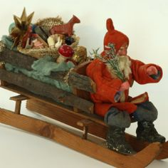 Vintage German Santa with a sleigh full of toys