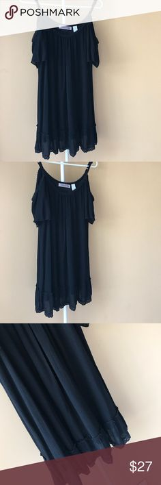 Girly Off-the-shoulder Flowy Sundress Feminine flowy black dress, has cute frills at the bottom and shoulder cutouts. Perfect for a spring/summer day with some sandals! Worn once, purchased from Tillys. Tilly's Dresses