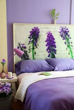 A beautiful poster or painting makes a perfect headboard.