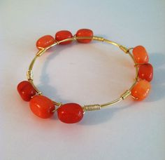 The Gainesville - gold wire wrapped bracelet bangle with orange semi-precious stones