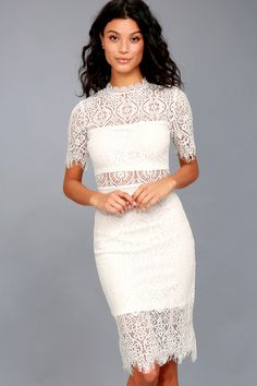 The Remarkable White Lace Dress is the perfect frock for any occasion! White lining creates a cool two-piece look beneath sheer lace as it forms a rounded, scalloped neckline, short sleeves, and a darted, sheath silhouette. Midi skirt with a sheer eyelash lace hem and hidden back zipper.