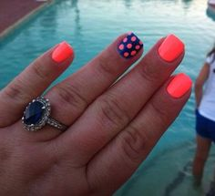 Summer nails...the navy blue and neon orange/pink contrast looks great here!