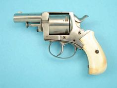 British Bull Dog Double Action Revolver with Ivory Grips .44 caliber centerfire, 5-shot cylinder, 2 1/2-inch round barrel with flat top; THE PACIFIC/BULL DOG engraved on topstrap; nickel-plated, with blued screws; cylinder pin doubles as fold-out ejector rod.