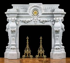 An imposing and profusely carved French Baroque style fireplace surround in lightly veined white Carrara Marble with an upper coffered stop fluted frieze and stepped entablature above an arched egg and dart band. Marble Fireplace Mantel, Marble Fireplaces, Fireplace Design, Fireplace Mantels, Indoor Fireplaces, Marble Fire Surround, Stone Fireplace Surround, Stone Mantel, Victorian Style Homes