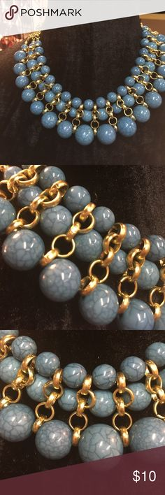 Bib Statement Necklace This Egyptian style blue entwined with gold Statement Necklace is detailed yet light very comfortable to wear Jewelry Necklaces