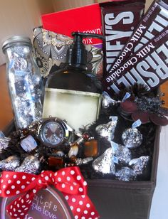 In my basket I used a cute brown scarf to fill it up and take the place of tissue paper, a brown watch, brown flower necklace, some lotion (actually vanilla scented but it was in pretty brown bottle), some fun patterned brown socks, a brownie mix, some Hershey kisses in a dollar store jar, and scattered around the basket, and quite a few bars of Hershey chocolate.