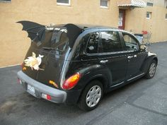 Someone made a PT Cruiser actually look good - as a Batmobile!  I MUST HAVE IT!!!