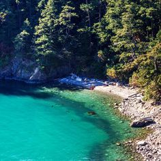 With rugged cliffs, pounding surf, and 77,000 feet of saltwater shoreline, this Pacific Northwest jewel at the northernwestern tip of Washington's Whidbey Island is a popular getaway for locals and visitors alike. Rosario Beach on Fidalgo Island is a stun