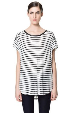Image 1 of T-SHIRT WITH FAUX LEATHER NECKLINE AND BACK ZIP from Zara