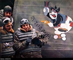 """France - 1941 Italian fighters on the Channel coasts. Pilotes have decorated their cockpit with a famous Walt Disney character. in""""Signal"""", February 1941."""