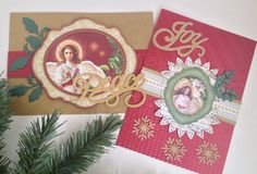 Beautifully embossed Anna Griffin holiday metallic card stock adorned with angel die cuts from K and Company, die cut holly, glittery gold word