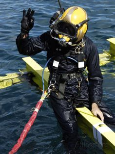 U.S. Navy Diver Signals An OK Sign To the Dive Supervisor Photographic Print by Stocktrek Images