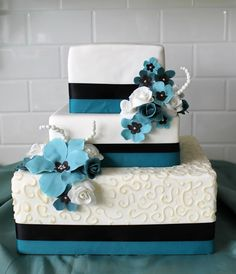 A Teal Wedding Cake: teal ribbons and flowers