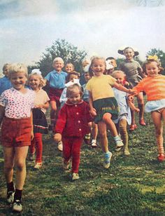This is USSR..., but the kids look pretty much as kids from my childhood... big hair bows for girls, short shorts for boys