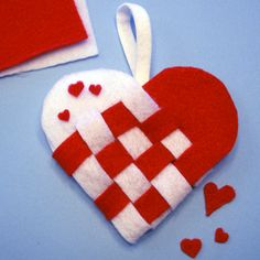 Felt Valentine's Day woven basket.  Instructions for paper & felt in link.  would make great Christmas tree ornament, too.
