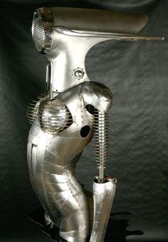 """ DeSoto Rising 2007""  l Welded steel, 1955 DeSoto fenders, trim and lights, acrylic base© Greg Brotherton"