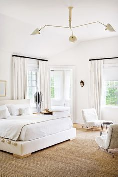 White bedroom with textured woven rug and furry chairs. Master bedroom home decor ideas, bedroom sets, contemporary furniture, home furniture, master bedroom furniture