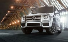 2014 Mercedes-Benz G63 AMG G-Class SUV, silver car, front view