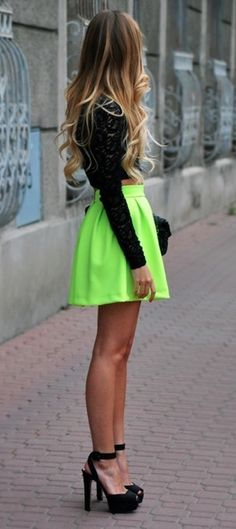 Love the bright skirt in contrast to the black.