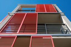 Performance & Personality - Red Folding Shutters by Hunter Douglas. #architecture #red #sun control #façade