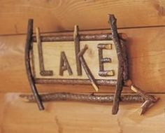 "THIS ITEM IS OUT OF STOCKThis twig lake signs points the way to the dock or beach. A must have for the lake house or cottage wall.20"" x 8"""