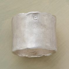 SENTIMENTS RING -- Intentionally imperfect, Saundra Messinger's organic, matte finished sterling silver band is set with one 4pt princess-cut diamond, subtle yet sparkling. Placement of stone will vary. Handmade in USA with an imported stone.