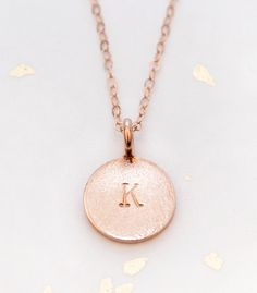Add a wire-wrapped birthstone and charm to this hand stamped initial necklace to create a unique gift for each bridesmaid. www.adorn512.com
