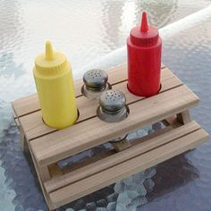 A miniature picnic table for condiments.