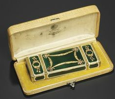A jewelled two-colour gold-mounted guilloché enamel vanity case marked Fabergé, workmaster's mark of Henrik Wigström, St. Petersburg, 1908-1917, with scratched inventory number 6092B \ marked in base, in an original fitted case stamped in Russian 'Fabergé St. Petersburg Moscow, Odessa'