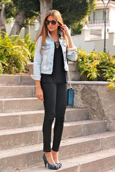 all black + light-washed denim jacket + ray bans + heels
