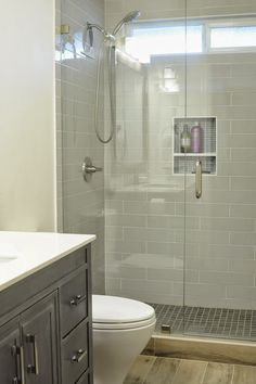Walk in Shower, Small bathroom with niche and brushed nickel fixtures. looks like 3x12 rectangle tiles on wall.