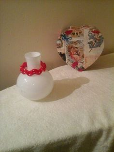 A plain vasevi added a piece of jewetly red and white for a decor look for valentines day