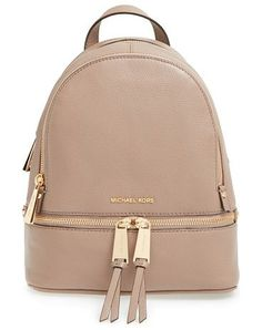 Extra small rhea zip leather backpack by MICHAEL Michael Kors. Gleaming exposed zippers trace the compact silhouette of a structured shoulder bag cut from butte...