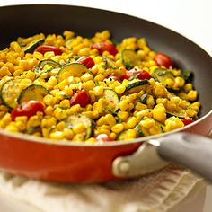 Melt butter in a 10-inch nonstick skillet over MEDIUM-HIGH heat. Add garlic, zucchini, and tomatoes; cook, stirring occasionally, until vegetables start to brown.