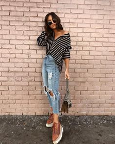 Casual style for women. Off the shoulder button up blouse. Denim ripped jeans and platform shoes.