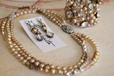 Swarovski stones and Vintage Gold pearl with gunmetal wire/settings...by MOSQUITA