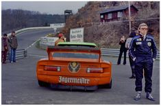 """The disappointed Harald Grohs standing next to his BMW 320 at """"Breidscheid"""" after he had to retire because of a technical defect."""