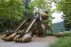 """This one is an absolute must-see. We were planning our next trip back before we even left this playground. The large brass structure of a gentle giant, by New York artist Tom Otterness, is the centerpiece to the newly renovated Riverfront Park in Aspinwall. Facebook Twitter Pinterest """"Playground"""" has four slides on the arms and…"""