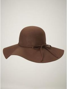 if I wore hats, I'd wear this one.  with a long dress and boots. and a bright teal necklace. :)