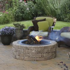 A Pavestone RumbleStone™ fire pit for summer nights #diy